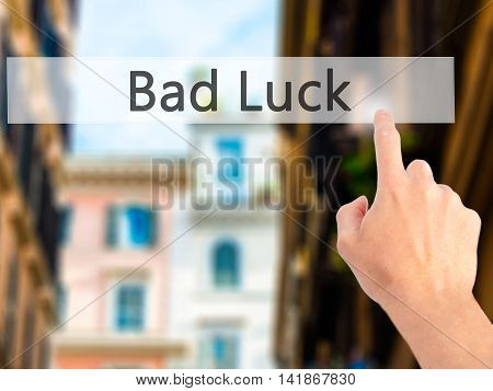 Bad Luck - Hand Pressing A Button On Blurred Background Concept On Visual Screen.