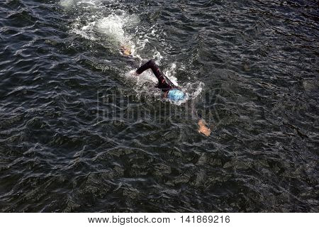 FREDERICIA DENMARK - AUGUST 6 2016: Triathlet swimming the triathlon competition Challenge Denmark in Fredericia Harbor August 6 2016.