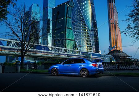 Moscow, Russia - June 18, 2016: Blue car Subaru Impreza WRX STI stay near International Business Center Moscow-City in Moscow at twilight