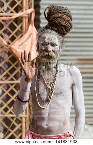 ALLAHABAD INDIA - FEB 13 - A Hindu holy man gives a blessing during the festival of Kumbha Mela on February 13th 2013 at Allahabad India.