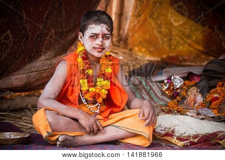 ALLAHABAD INDIA - FEB 13 - A young Hindu priest sits inside of his tent during the festival of Kumbha Mela on February 13th 2013 at Allahabad India.