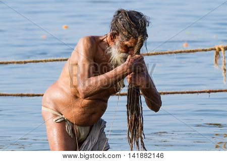 Hindu Sadhu Bathing At The Kumbha Mela, India.