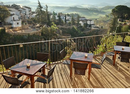 Cafe view in Ronda, Andalusia, Spain. Old town cityscape on the Tajo Gorge