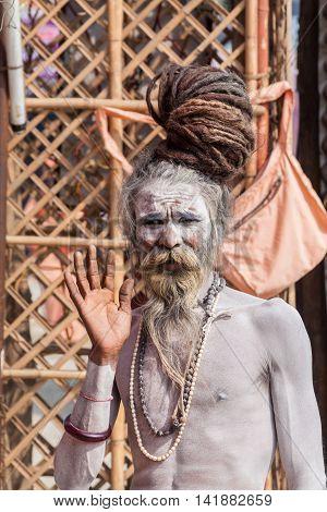 ALLAHABAD, INDIA  FEB 13th - A  naga-baba sits at the Kumbha Mela on February 13th 2013