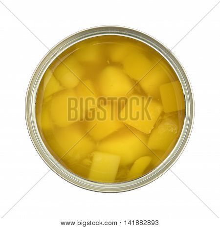 Top view of an opened can of diced mangoes in light syrup on a white background.