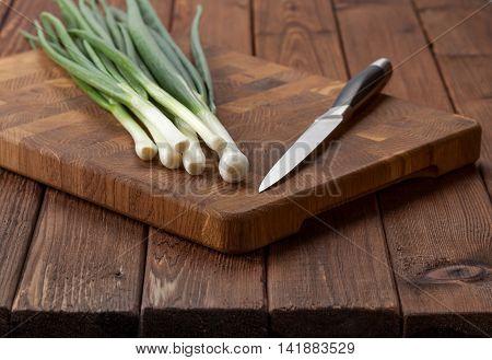 Spring Onions Still Life On Kitchen Table