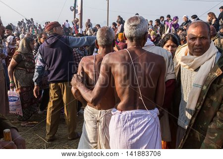 ALLAHABAD INDIA - FEB 10 - Hindu pilgrims approach the confluence of the sacred rivers to take a holy bath during the festival of Kumbha Mela on February 10th 2013 at Allahabad India.