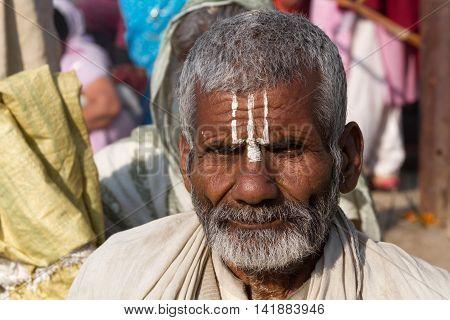 Allahabad India- CIRCA Jan 2013 - A Hindu pilgrim on the banks of the Ganges River at Kumbha Mela circa Jan 2013.