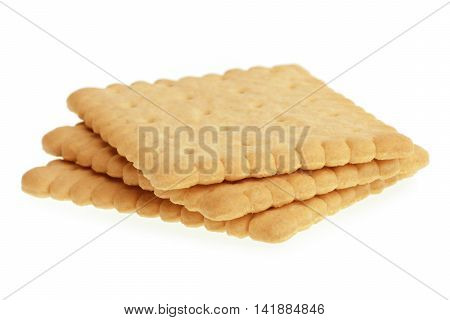 Biscuits Isolated On White Background. Stack of three biscuits.