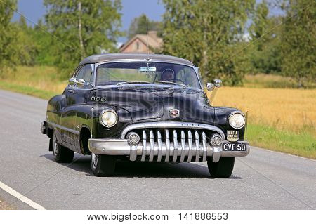 SOMERO, FINLAND - AUGUST 6, 2016: Black Buick Super Eight classic car takes part in the 90 km Maisemaruise 2016 drive along scenic roads of Tawastia Proper Finland. Public event.