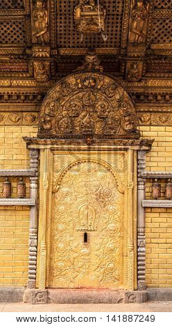 A gold gilded temple door in Swayambhunath, Nepal.