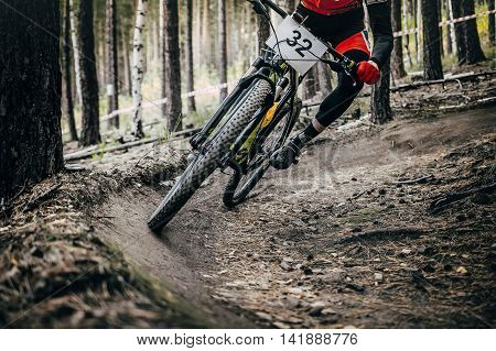 cyclist mountainbiker rides in forest. extreme sports cross-country