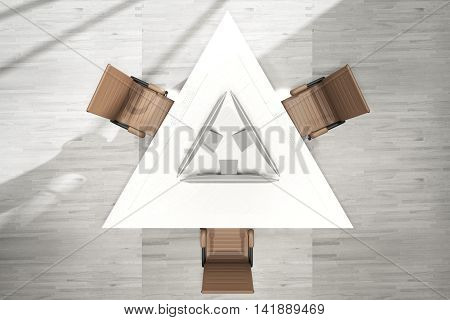 Top view of abstract triangular office table with three computer monitors and swivel-chairs on grey wooden floor background. 3D Rendering