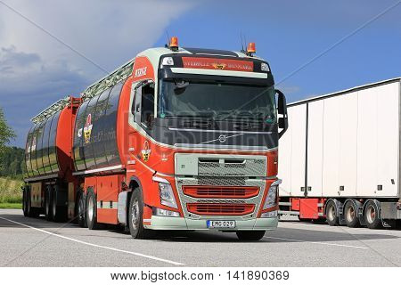 SALO FINLAND - AUGUST 7 2016: Colorful Volvo FH 500 tank truck of Johns Rasmussen Denmark parked on the asphalt yard of a truck stop in South of Finland.