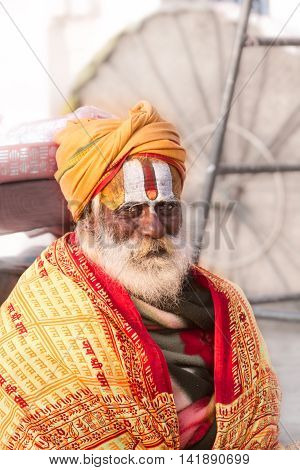 VARANASI, INDIA - FEB 18 - A Hindu priest in Varanasi wearing sectarian markings on his face.
