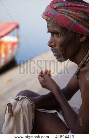 VRINDAVAN, INDIA - OCT 10 - A sadhu chants on beads on the banks of the Yamuna in Vrindavan on October 10th 2009