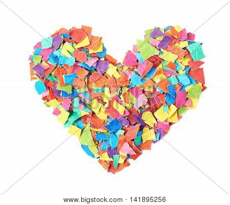 Heart shape made of torn pieces of colorful paper isolated over the white background