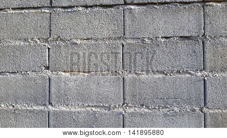 close up of a cinder block wall along a road near Songkhla, Thailand