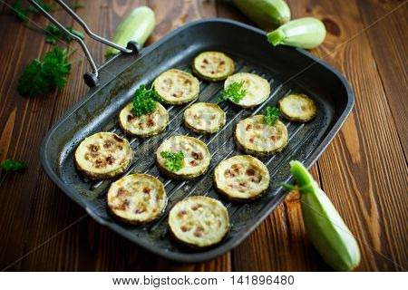 zucchini baked with sauce in the pan