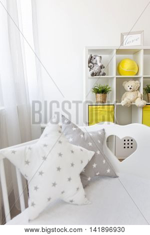 Cute star shaped pillow in coy baby room