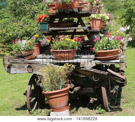 Detail Of An Old Wooden Wagon With Many Pots