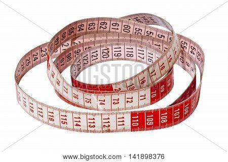 Studio shot isolated coiled red and wite dressmaking tape measure marked in centimetres on white