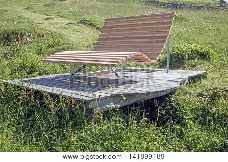 New wooden park bench at a park