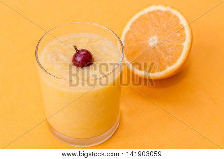 Orange Smoothie With Gooseberry On Orange Background