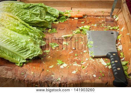 Cleaver Vegetables On A Wooden Board Set To Meet The Lettuce