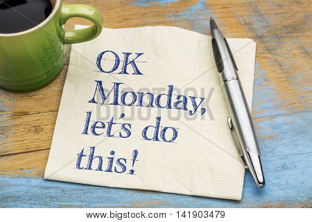 OK Monday, let's do this! - handwriting on a napkin with a cup of espresso coffee