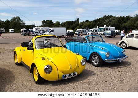 Celle, Germany - August 7, 2016: A yellow and a blue Volkswagen Kaefer cabriolet at the annual Kaefer Meeting