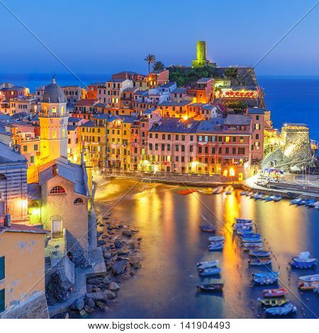 Aerial night view of Vernazza fishing village, seascape in Five lands, Cinque Terre National Park, Liguria, Italy.