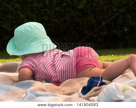baby with hat from behind
