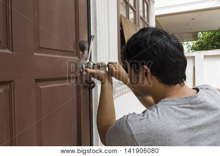locksmith try to open the door by key maker tools - can use to display or montage on products