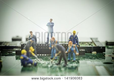 mini boss check the worker do the job on motherboard with light fare - can use to display or montage on products