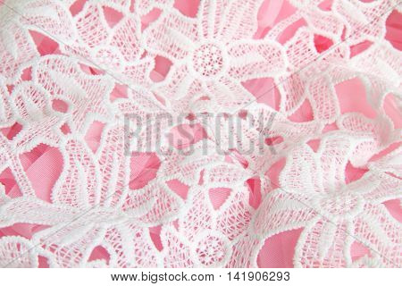 Floral lace layered over a pink tutu.