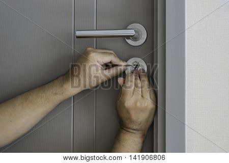 locksmith try to open the door by screwdriver - can use to display or montage on products