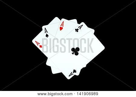 Ace of clubs and other ace on black background