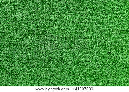 Green grass artificial background top view texture