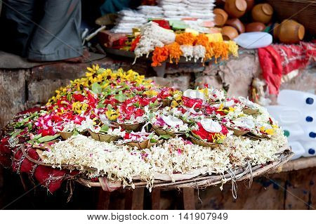 Puja flowers for aarti ritual. Puja flowers offering for the Ganges river in Varanasi India.