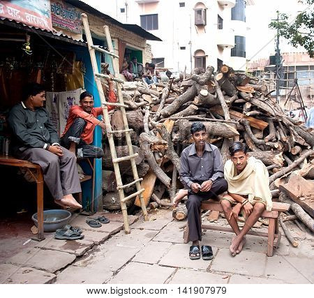 Varanasi, India - Jule 30, 2011: Mens working, selling, and buying firewood for Hindu funeral pyres on bank of river Ganges.