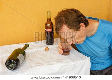 a man swept two bottles of wine