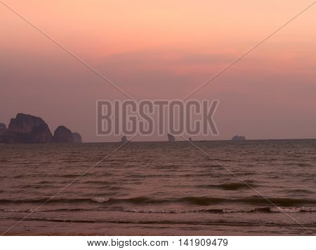 Beach at sunset sky orange, Krabi  Thailand.