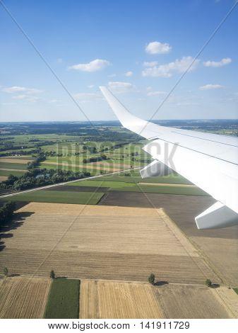 An image of a view thru an airplane window