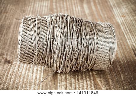 Skein jute twine on old wooden table background