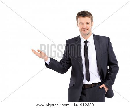 Happy smiling business man showing blank area for sign or copysp