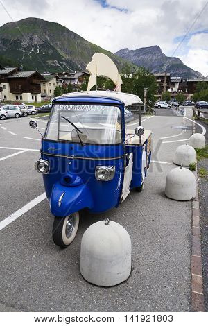 Livigno, Italy – August 1: Limited Edition Model Of Three-wheeled Vehicle Piaggio Ape Calessino Stan