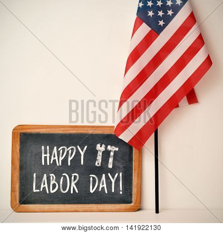 a wooden-framed chalkboard with the text happy labor day written in it and a flag of the United States, against an off-white background