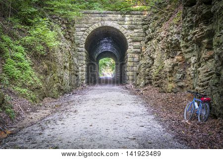 MKT tunnel and bike  on Katy Trail at Rocheport, Missouri. The Katy Trail is 237 mile bike trail stretching across most of the state of Missouri converted from an old railroad.