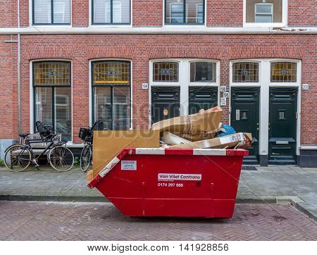 The Hague the Netherlands - July 04 2016: rubbish skip full of cardboard